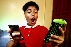 Teen using two smartphones Royalty Free Stock Image