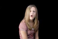 teen uttrycka för displeasureflicka Royaltyfri Foto