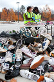 Teen Volunteers Sort Through Sneakers At Recycling Event Royalty Free Stock Images