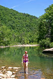 Teen Wading in Mountain Stream stock image