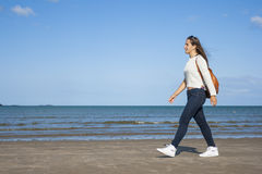Teen walking on the beach Royalty Free Stock Photos