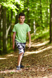 Teen walking through a forest Royalty Free Stock Images