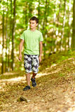 Teen walking through a forest Royalty Free Stock Photos