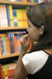 Teen wants to buy books. And is inconclusive stock photo