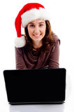 Teen Wearing Christmas Hat Working On Laptop Stock Photography