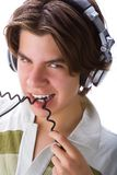 Teen wearing headphones Royalty Free Stock Photo