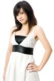Teen In White Dress. A cute Asian teenager in white dress on white background Royalty Free Stock Images