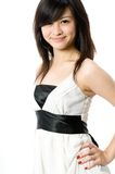 Teen In White Dress. A cute Asian teenager in white dress on white background Royalty Free Stock Image