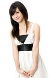 Teen In White Dress. A cute Asian teenager in white dress on white background Stock Images