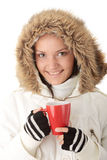 Teen winter girl drinking Royalty Free Stock Photography