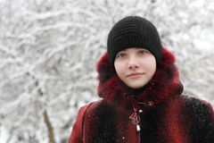 Teen in winter park Royalty Free Stock Photos