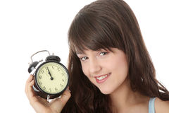A teen woman with alarm clock Royalty Free Stock Image