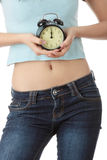 A teen woman with alarm clock Royalty Free Stock Images
