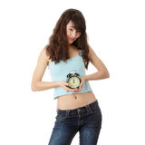 A teen woman with alarm clock Stock Photo
