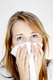 Teen woman with allergy or cold. Young female having a cold Royalty Free Stock Photography
