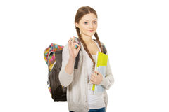 Teen woman with backpack showing perfect sign. Stock Image