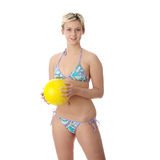 Teen woman in bikini playing volleyball Stock Photography