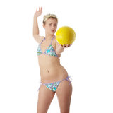 Teen woman in bikini playing volleyball Royalty Free Stock Photography