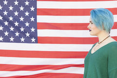 Teen woman with blue hair isolated on a United States of America stock photography