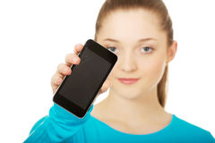 Teen woman with a broken cell phone. Tern woman with a broken cracked phone screen royalty free stock images