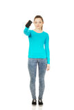 Teen woman with a broken cell phone. Tern woman with a broken cracked phone screen stock images
