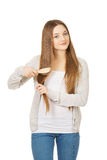 Teen woman brushing her hair. Stock Photography