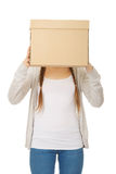 Teen woman covering face with a box. Royalty Free Stock Photo