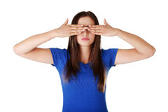 Teen woman covering her eyes Royalty Free Stock Image