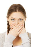 Teen woman covering her mouth. Stock Photos