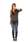 Teen woman covering her mouth with hand.  Stock Photography