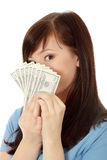 Teen woman with dollars. Royalty Free Stock Photography