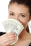 Teen woman with dollars. Royalty Free Stock Photo