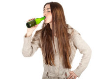 Teen woman drinking beer Royalty Free Stock Images
