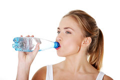 Teen woman drinking mineral water Stock Photo