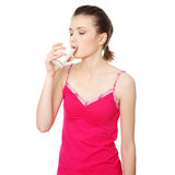 Teen woman drinking water Stock Image