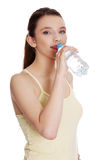Teen woman drinking water Stock Images