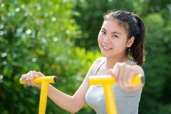 Teen woman exercise in park. Stock Images