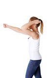 Teen woman with fists up  Stock Images