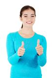 Teen woman gesturing thumbs up Stock Images