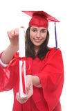 Teen Woman at Graduation. A young teenage woman at graduation holding her diploma Royalty Free Stock Photos