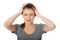Teen woman with headache Stock Photo