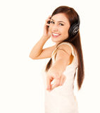 Teen woman with headphones pointing on you Stock Images