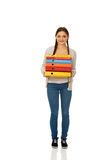 Teen woman holding binders. Royalty Free Stock Photo