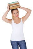 Teen woman holding books on head Stock Photography