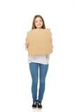 Teen woman holding cardboard sheet. Stock Image