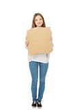 Teen woman holding cardboard sheet. Stock Images