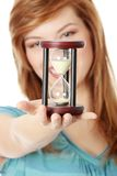 Teen woman holding hourglass Royalty Free Stock Photo
