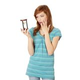 Teen woman holding hourglass Royalty Free Stock Images