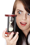 Teen woman holding hourglass Stock Image