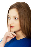 Teen woman with hush gesture. Stock Photo
